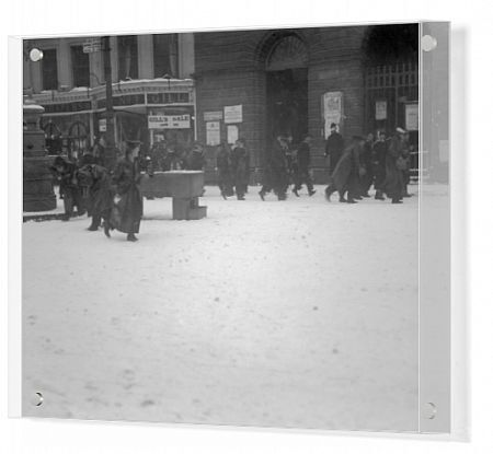 Men in naval uniforms snowballing by the fountain outside City Hall during the First World War