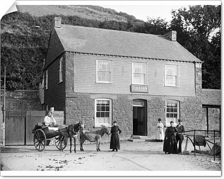 Signage on the inn states 'S.J. Southey licensed to let a horse & trap on hire, boats for pleasure or fishing purposes'. Samuel Southey is seated in the trap. His wife, Mrs Agnes Southey is standing at the railings with their son, Joe Southey
