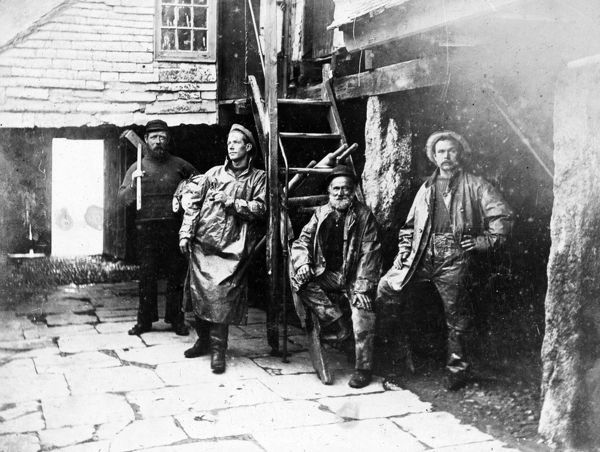Interior of 'The Active Cellar' with four fishermen. The Active was demolished between 1905 and 1906. Photographer: Ennor