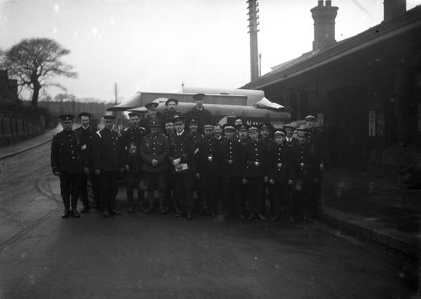 A group of Royal Naval Auxiliary Hospital ambulance men etc