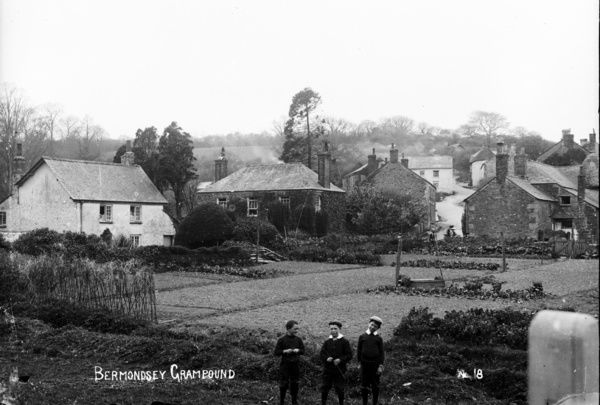 Bermondsey - houses seen across allotment. Three boys in foreground. Early 1900s. Photographer: Samuel John Govier