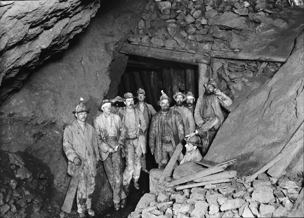 Group (or Pare) of 9 miners underground. A pare is a group of family members or friends recruited to work in the mines. Photographer: John Charles Burrow