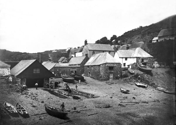 A view of Cadgwith harbour with small boats drawn up on beach. Photographer: Arthur William Jordan