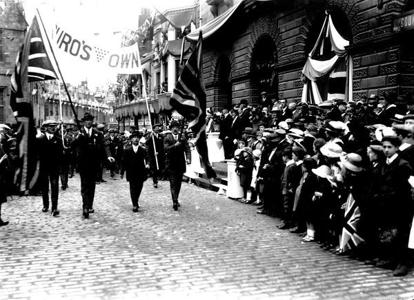 "Procession with banner ""Truro's Own"" passing City Hall from Princes Street, Truro, 19 July 1919. Photographer: A.W. Jordan"