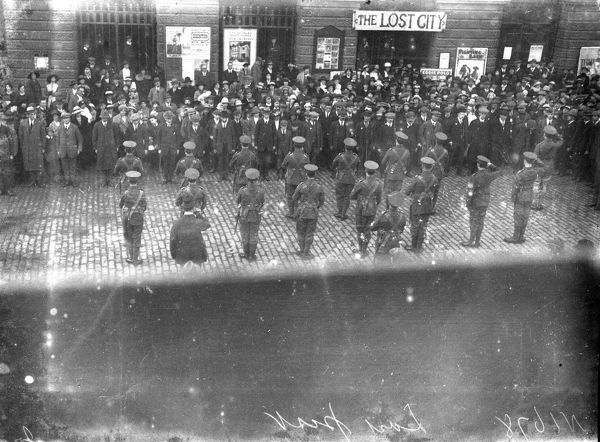 Soldiers (viewed from the rear) outside City Hall, at the end of the First World War or early 1920s. Photographer: Arthur William Jordan