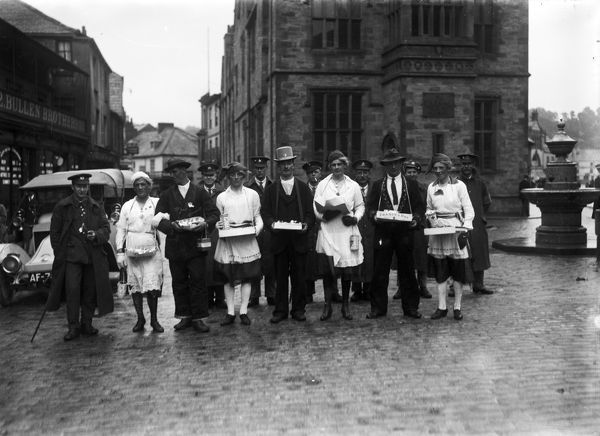 "Red Cross collectors in fancy dress for ""France's Day"", on Boscawen Street. Bullen Brothers shop is to the left of the picture. Photographer: Arthur William Jordan"