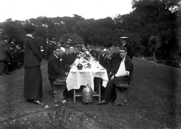 A group of wounded sailors having tea on the lawn at Trefusis. Trefusis in Mylor was a Red Cross Auxiliary Hospital during the First World War. Photographer: Arthur William Jordan