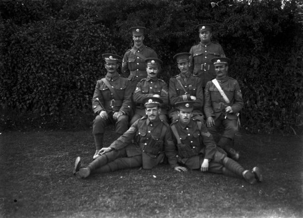 Picture of Thomas Rendle (born Bedminster, Bristol on the 14th December 1884 and who was awarded the Victoria Cross) with some of his battalion colleagues, including an officer. He sits in the middle row, second from the left. Photograph perhaps taken in 1915