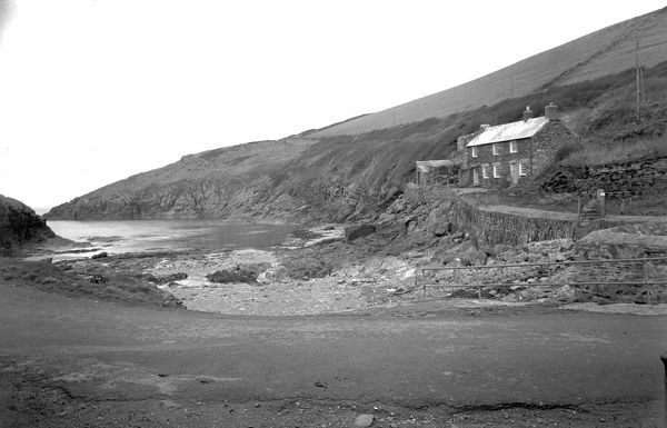 View of the cottages on the north side of the beach at Port Quin with the cliffs behind