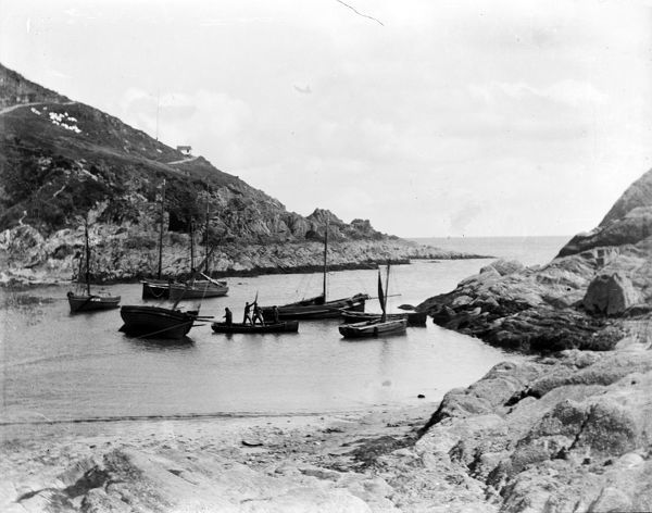 Cove below harbour looking seawards with fishing boats. Photographer: Alexander Edward Hurford