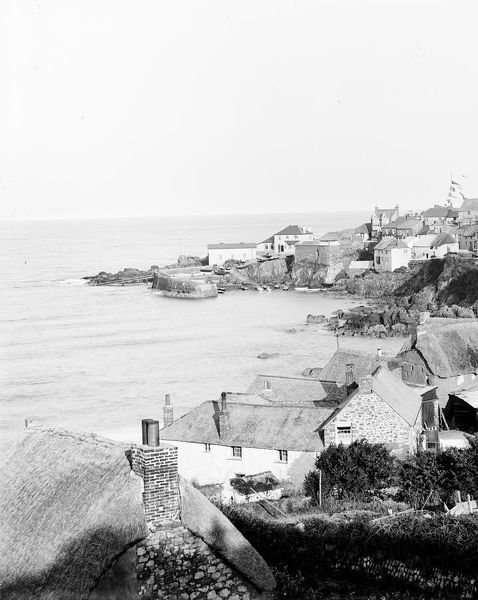 A good view of the lower part of the village and the harbour, with the Life Boat Station and slip way clearly visible. Photographer: Herbert Hughes