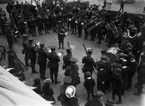 The band are pictured playing to a crowd. Possibly at The Green in Truro, 1915. Photographer: A.W. Jordan