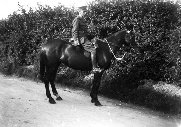Army officer on horseback during 3rd Duke of Cornwall's Light Infantry recruiting march during the First World War. Photographer: Arthur William Jordan