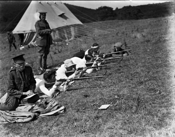 1st Volunteer Battalion, Duke of Cornwall's Light Infantry Rifle Meeting at Idless shooting range. Monday 11th to Friday 15th August 1919. Ladies practising with military personnel looking on. Photographer: Arthur William Jordan