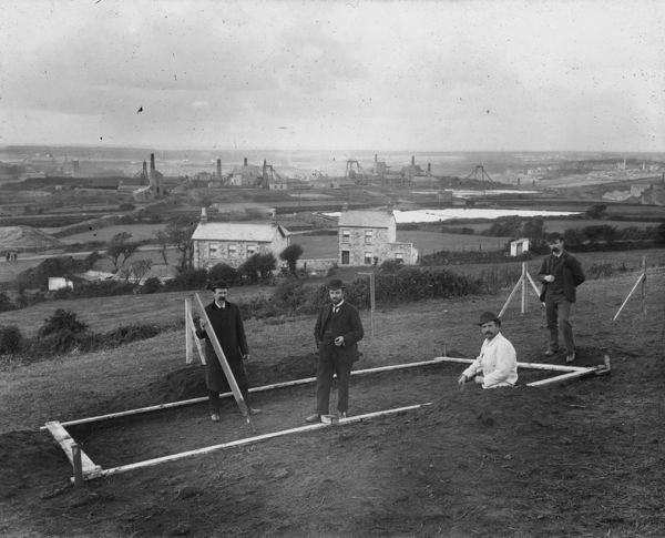 Cutting the first sod for the Williams Shaft, also known as New Shaft. Mine workings and All Saints Church, Tuckingmill, can be seen in the background
