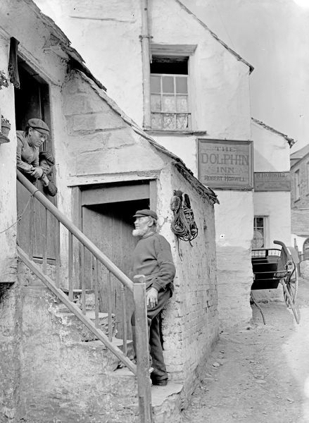 The Dolphin Inn. Rachel Thomas and a young boy at the doorway and a Mr. Hill who was a grandfather to Lillian Thomas (nee Prout). Photographer: Herbert Hughes