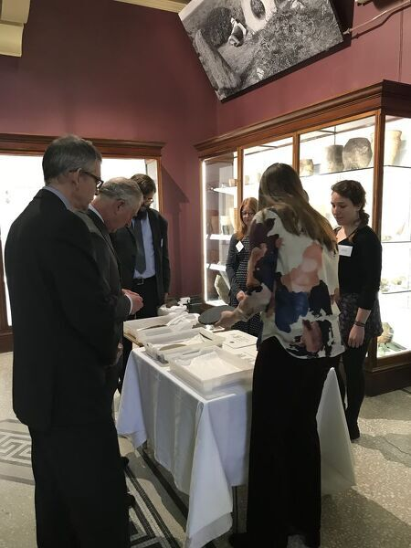 The Portable Antiquities Scheme Finds Liaison Officer for Cornwall shows some archaeological artefacts to the Duke of Cornwall