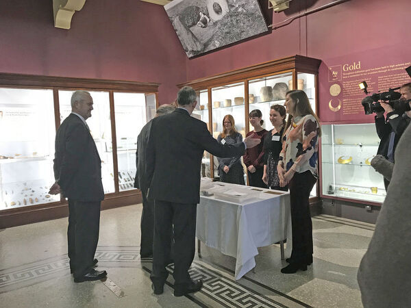 The Director of the Royal Cornwall Museum, introduces the Portable Antiquities Scheme Finds Liaison Officer for Cornwall to the Duke of Cornwall. Standing to the left is the Chairman of the Royal Institution of Cornwall. Standing by the table