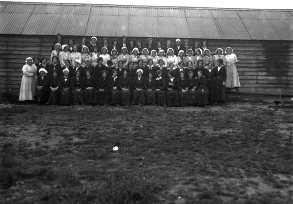 Female employees posed at the National Explosives Works, probably during World War One