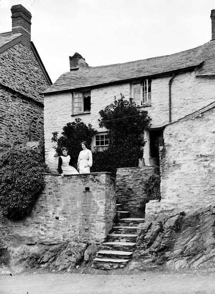 Two girls at the top of cottage steps (Gwendoline & ? Mutton). Photographer: Herbert Hughes