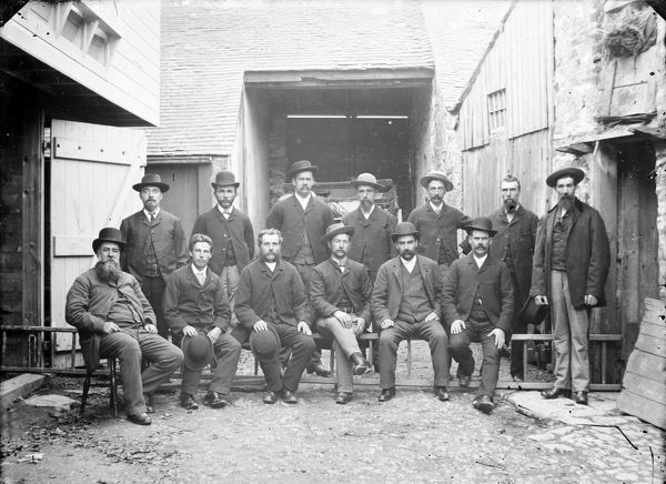 A group of 13 miners, including Captain Alexander Pope, before leaving for South Africa