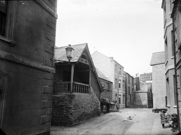 The Fisherman's Arms sign shows the landlord, W. Alford (who was there between 1856-1888). Three small children are enjoying the moment in the foreground. A donkey and cart waits outside the Guild Hall. Photographer: Surgeon Captain John Campbell