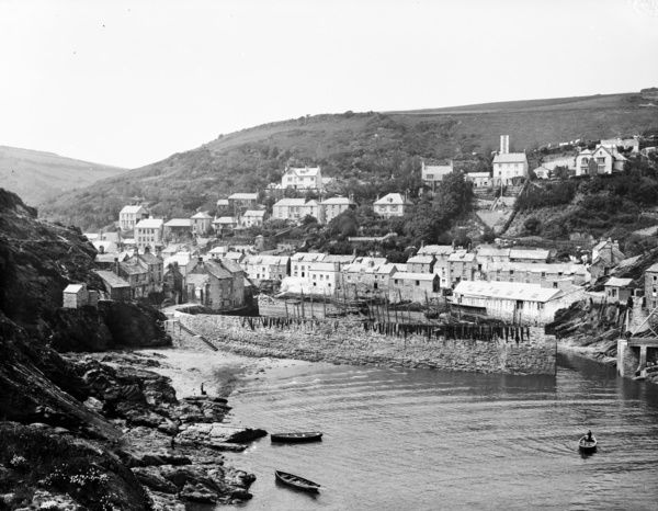 General view over the harbour from the sea, at low tide, with rowing boats. Photographer: Herbert Hughes