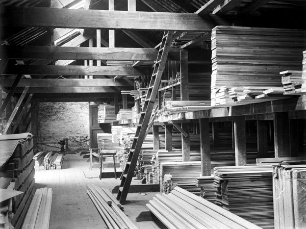Stacks of timber in shed. Harvey & Company Ltd. were timber importers. Photographer: Arthur William Jordan