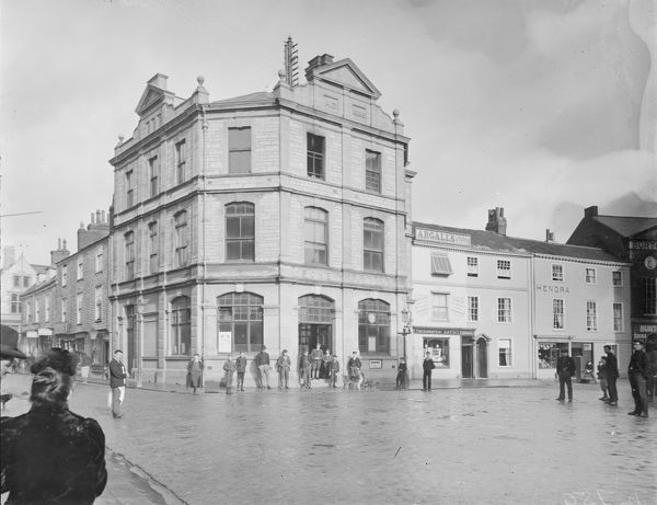 A view from Kings Street looking across into High Cross with the Post office building built in 1886 by Silvanus Trevail in the centre of the picture