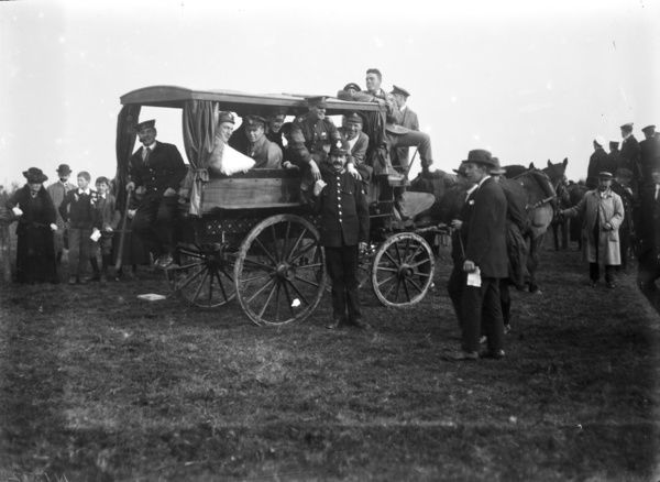 Wounded soldiers in a horse drawn ambulance probably in the grounds of the Auxiliary Naval Hospital or possibly the end of First World War celebrations at Ladock