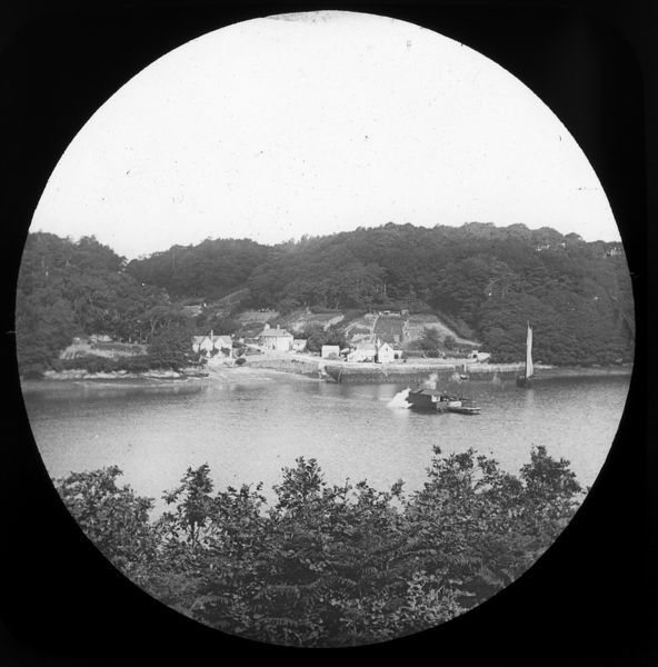 King Harry Ferry in mid-stream from the Philleigh side. The steam driven chain ferry was introduced in 1888. Photographer: Unknown