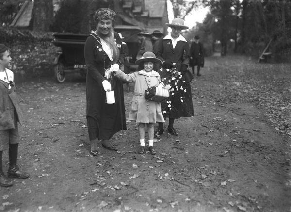 Two women and a girl with collecting tins by Ladock School on 'Our Day' 30 October 1917. There is a motor car AF187 in the background. Photographer: Arthur William Jordan