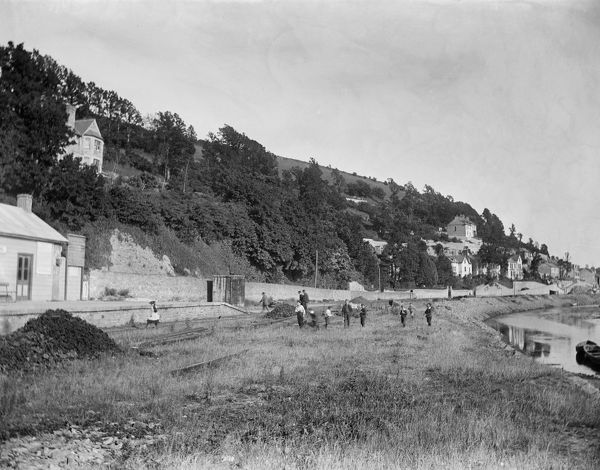 The far end of the railway station in Looe with children playing and the foreshore looking towards Looe bridge. Photographer: Surgeon Captain John Campbell