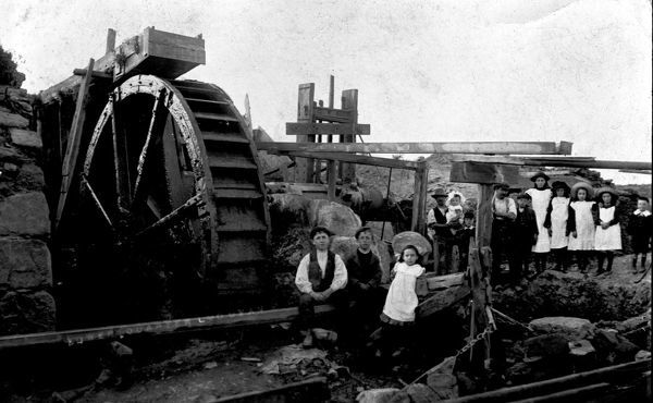 With waterwheel and children. Photographer: Dr R.D. Slack