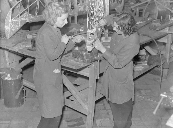Workers in the aircraft component repair department during the Second World War in what was the H.T.P. Motors showroom. Aircraft repair staff comprised 100 operatives, 50% of which were women. At their peak they produced 500 components a month for Spitfires