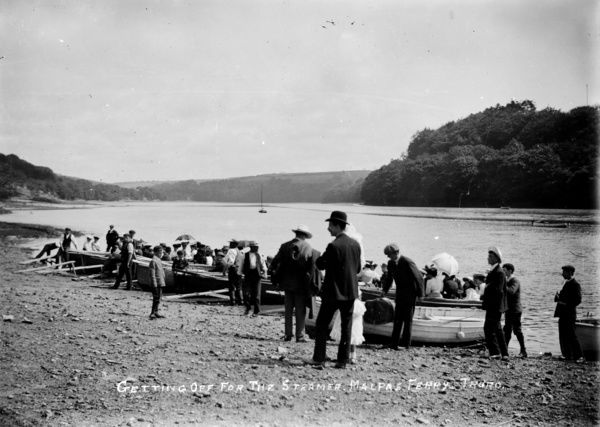 'Getting off for the steamer, Malpas Ferry'. A group of rowing boats, full of passengers prepare to embark