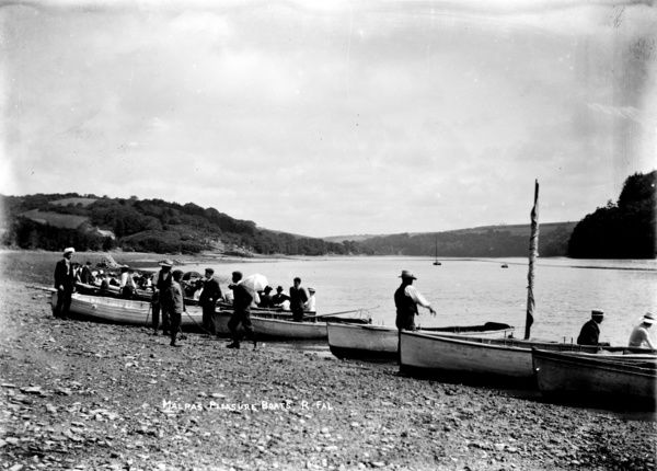 A group of rowing boats, full of passengers prepare to embark from the foreshore at Malpas