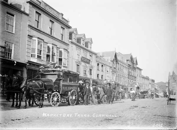 A view of Boscawen Street on market day with a long line of horse drawn buses and their coachmen waiting for passengers