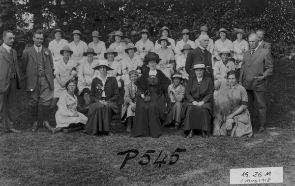 A large group of the Women's Land Army. Pictured are: front row centre, Ingeborg, Lady Molesworth-St Aubyn; standing extreme left, Mr Page of Ellenglaze, Cubert; next to him, Mr W