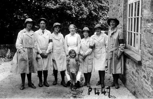 A group of Women's Land Army members pictured with a young girl, thought to be Joy Jennings, at their training centre at Tregavethan Farm