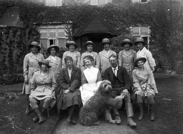 Nine members of the Women's Land Army pictured with the owners of Tregavethan Farm, a Women's Land Army training centre, and their dog. Back row left to right: Ms. Brown, Mrs. Ford, Ms. Trejeweth, Ms. Nora Lock, possibly Ms. Vera Dunfrane, Ms