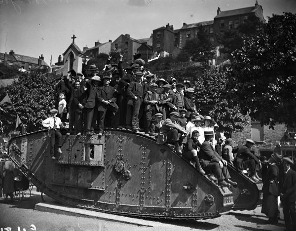 World War One tank with bystanders. The tank is a 'female' model, with machine gun operation from the side. Photographer: Arthur William Jordan