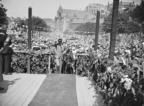 The Prince of Wales, later King Edward VIII, at a ceremonial occasion on The Moor, surrounded by crowds of people. Possibly for the opening of the Prince of Wales Pier. Photographer: Unknown