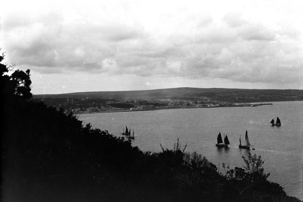 General view over Mounts Bay from hill above Penlee, Newlyn. Penzance is in the middle distance. Photographer: Herbert Hughes