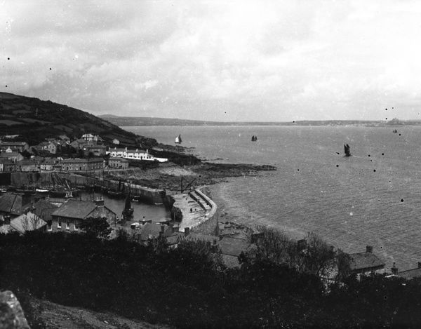 A view over Mousehole harbour, with St Michael's Mount in the background. Photographer: Herbert Hughes