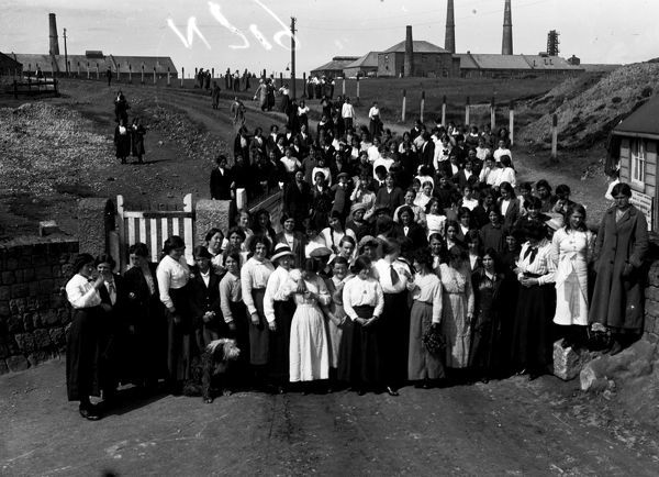A group of women workers at the front entrance, with the works in the background, during the First World War. Photographer: Arthur William Jordan