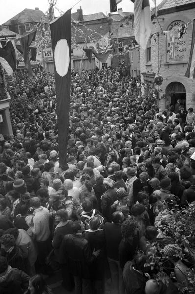 Crowds of people on the corner of Lanadwell Street and Broad Street on 'Obby 'Oss Day