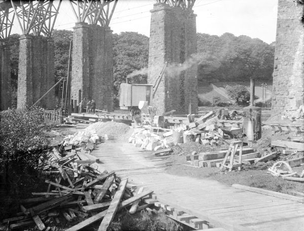 A general view of Brunel's old Carnon Viaduct showing the early stages of construction of the new replacement pillars, with some of the workforce in the background