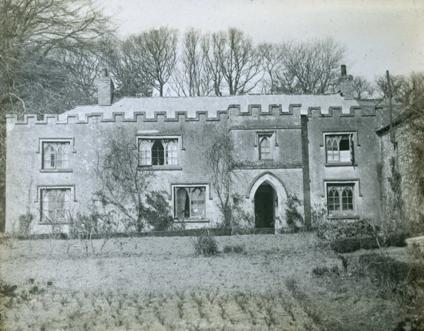 A view of the Parsonage, also known as the Rectory, taken from the garden. The property, which is now a house, is believed to date from the 17th century, or earlier, and is said to have been built by Prior Vyvyan of Bodmin. Photographer: Unknown