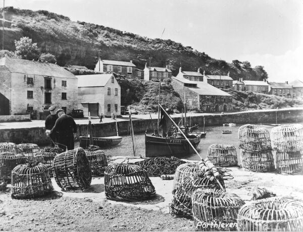 Inner harbour with crab pots on harbour wall in foreground. Boats PZ105 and PZ500 are pictured. Photographer: Unknown